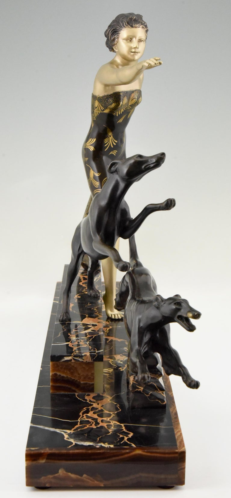 Patinated Art Deco Sculpture Lady with Dogs by Uriano, France, 1930 For Sale