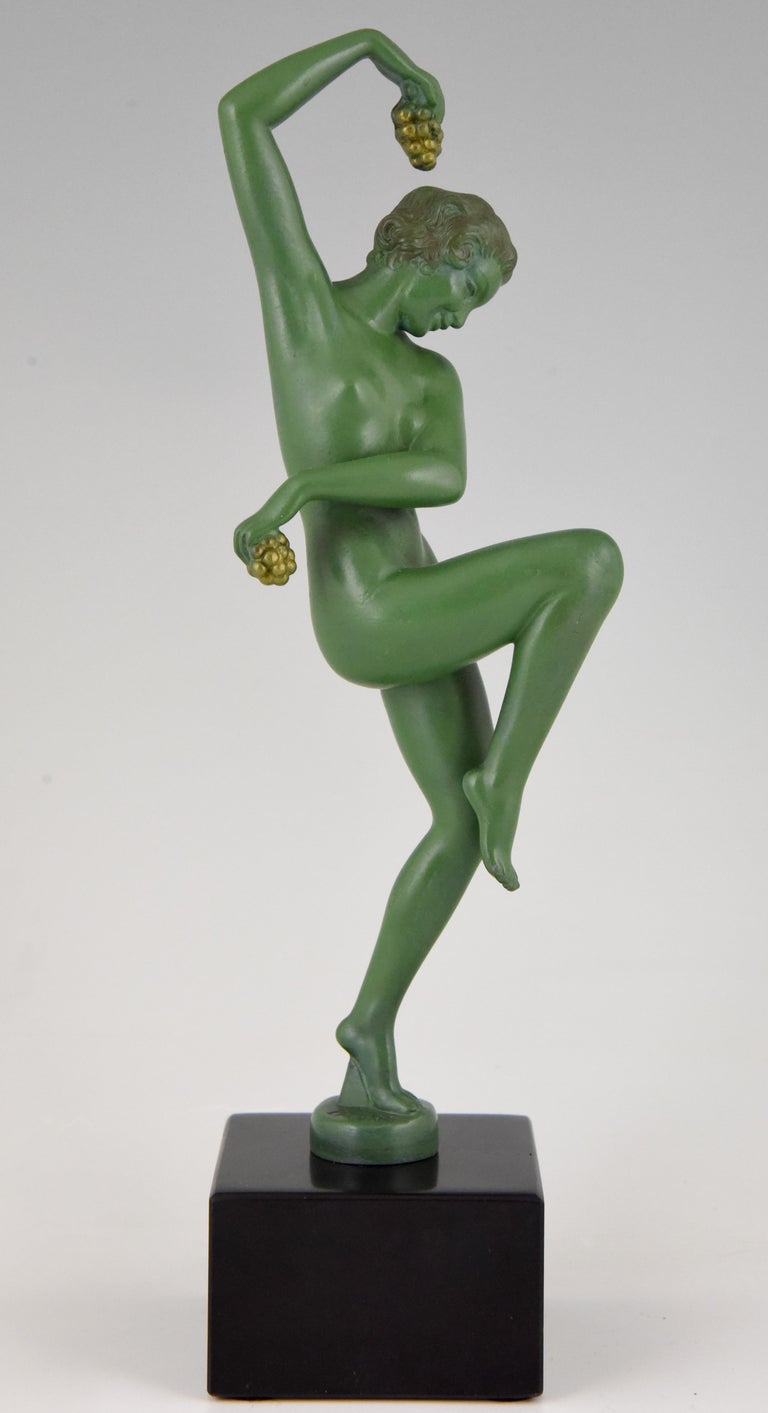Lovely Art Deco sculpture of a nude dancer with grapes signed by the French artist Denis. Patinated art metal on a Belgian Black marble base, circa 1930.