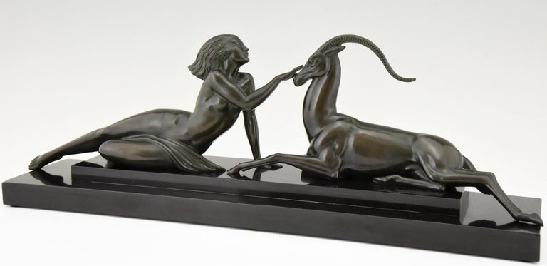 Seduction, elegant Art Deco sculpture of a nude lady with gazelle by Pierre Le Faguays for Max Le Verrier, signed Fayal. Art metal with dark green patina on a Belgian Black marble base. France 1930