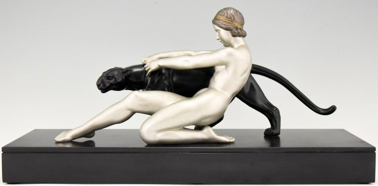 """Art Deco sculpture of a nude with a panter on a Belgian black marble base by the French artist Alexandre Ouline, who worked in France, 1918-1940. The Art metal sculpture has a silver and black patina. Literature: """"Animals in bronze"""" by Christopher"""