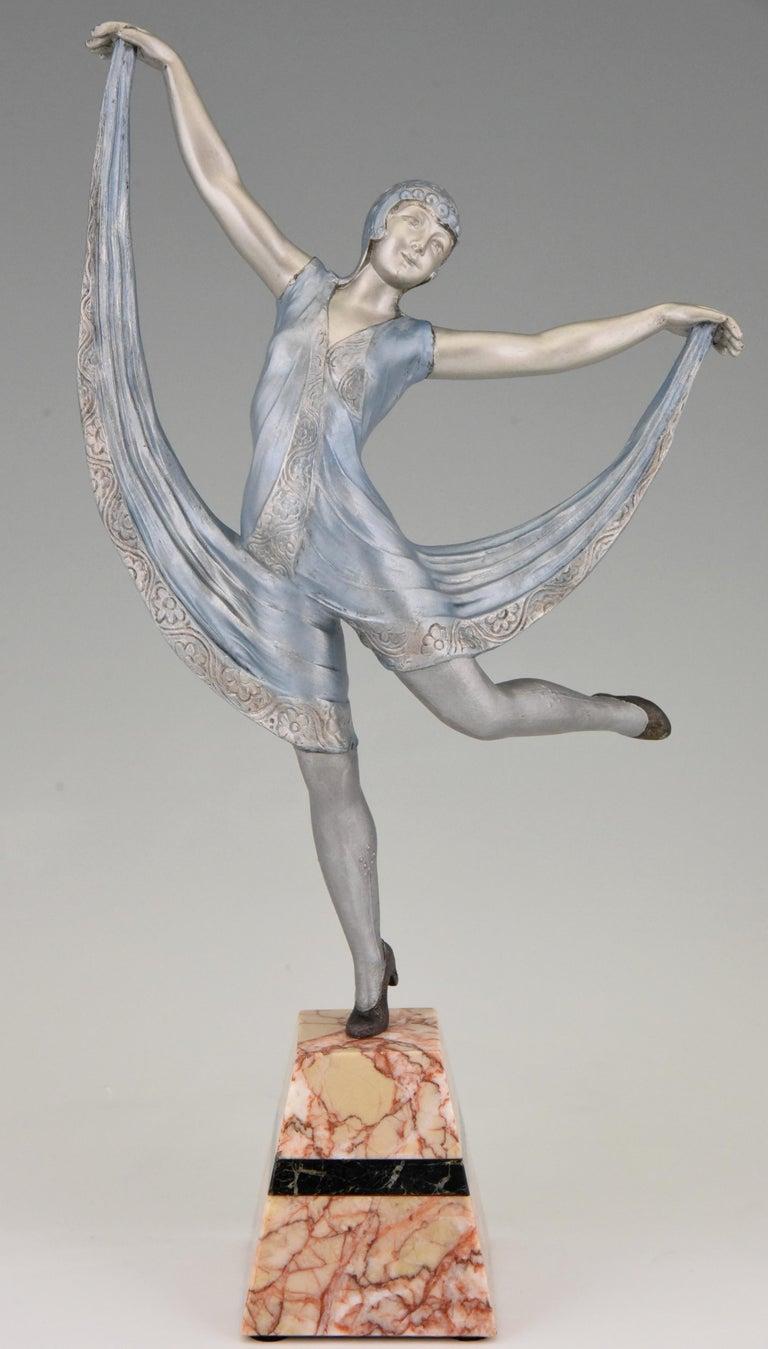Lovely sculpture of a female dancer in a blue dress. The work is signed by Limousin, a French sculptor. Executed in art metal with silver and light blue patina, the base is in marble and has a black marble inlay. France, 1930.