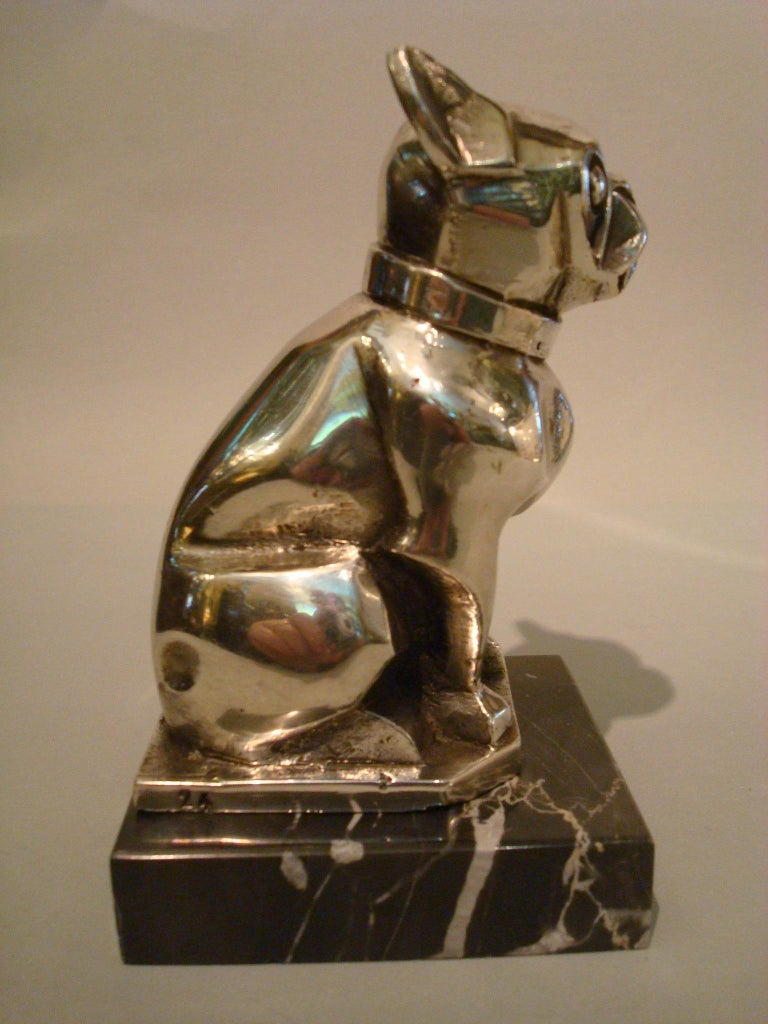Art Deco or Cubist sculpture of a French bulldog bookend or paperweight. Made of silvered bronze, mounted over a Black Italian marble base. Made in France, 1920s. Marked France and 24.