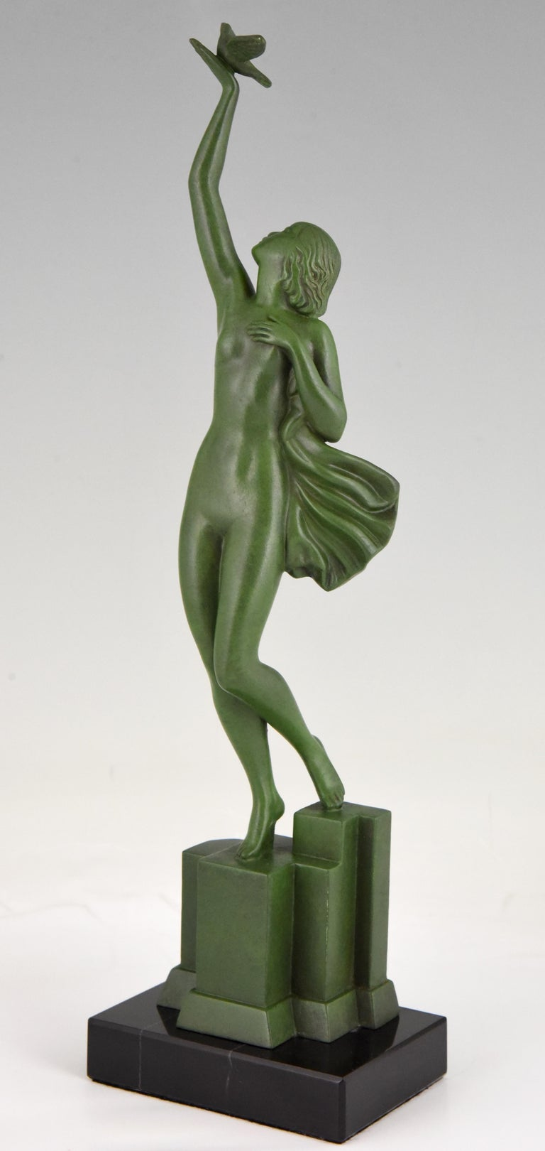 Message of love, Art Deco sculpture of a nude holding a dove signed Fayral, pseudonym of Pierre Le Faguays. France 1930. Patinated art metal on black marble base.   Literature: