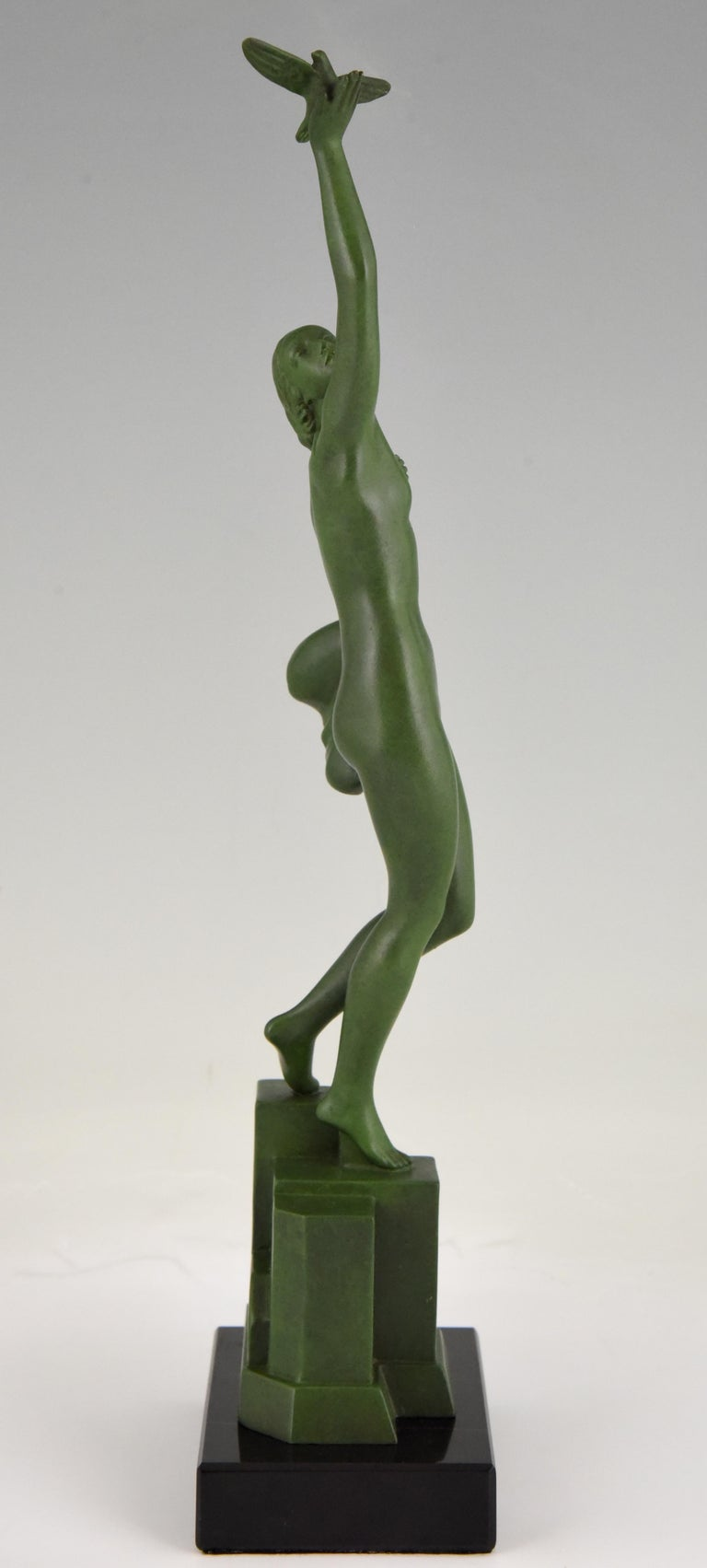 Metal Art Deco Sculpture of a Nude with Dove Fayral Pierre Le Faguays, France, 1930 For Sale