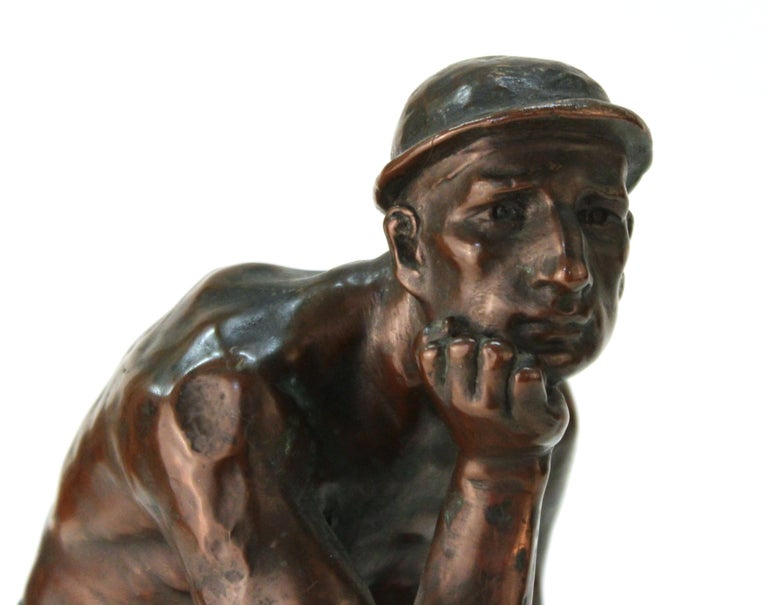 Art Deco period European sculpture of an industry worker, illegibly signed. The piece is made of copper clad metal and is in great antique condition with age-appropriate wear.