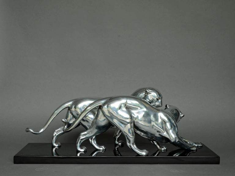 Large, very elegant and rare Art Deco sculpture by Plagnet, depicting a pair of panthers (couple de panthères) from France, circa 1930.