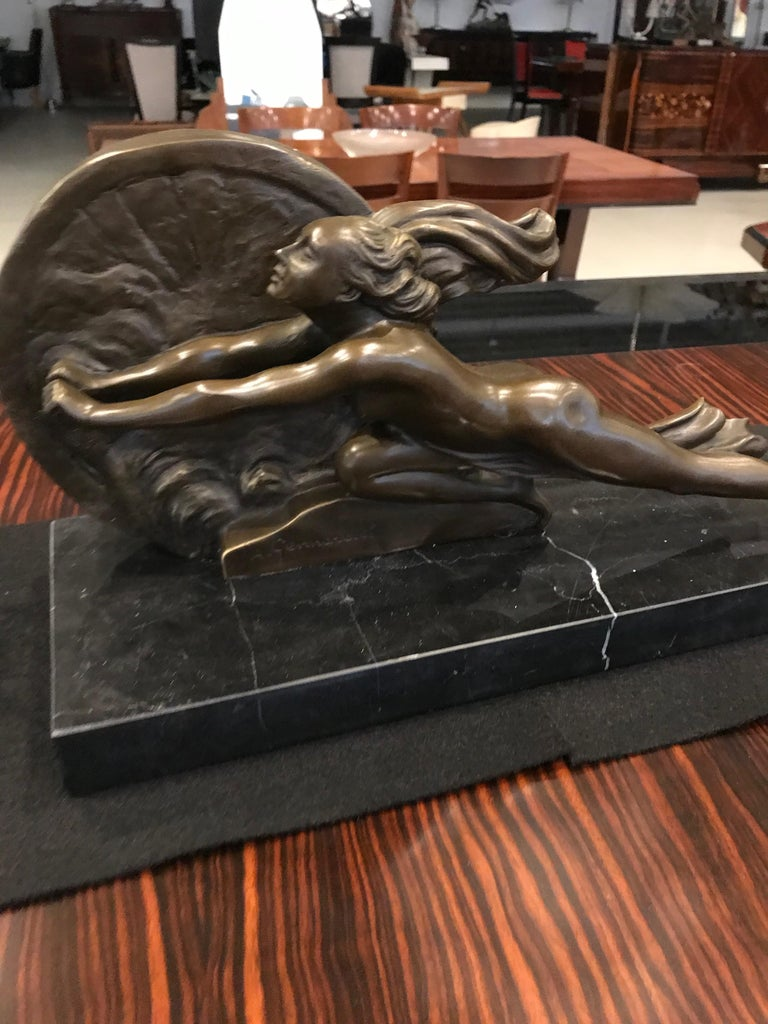 Towards destiny is an Art Deco sculpture on marble base and signed by Amadeo Gennarelli.