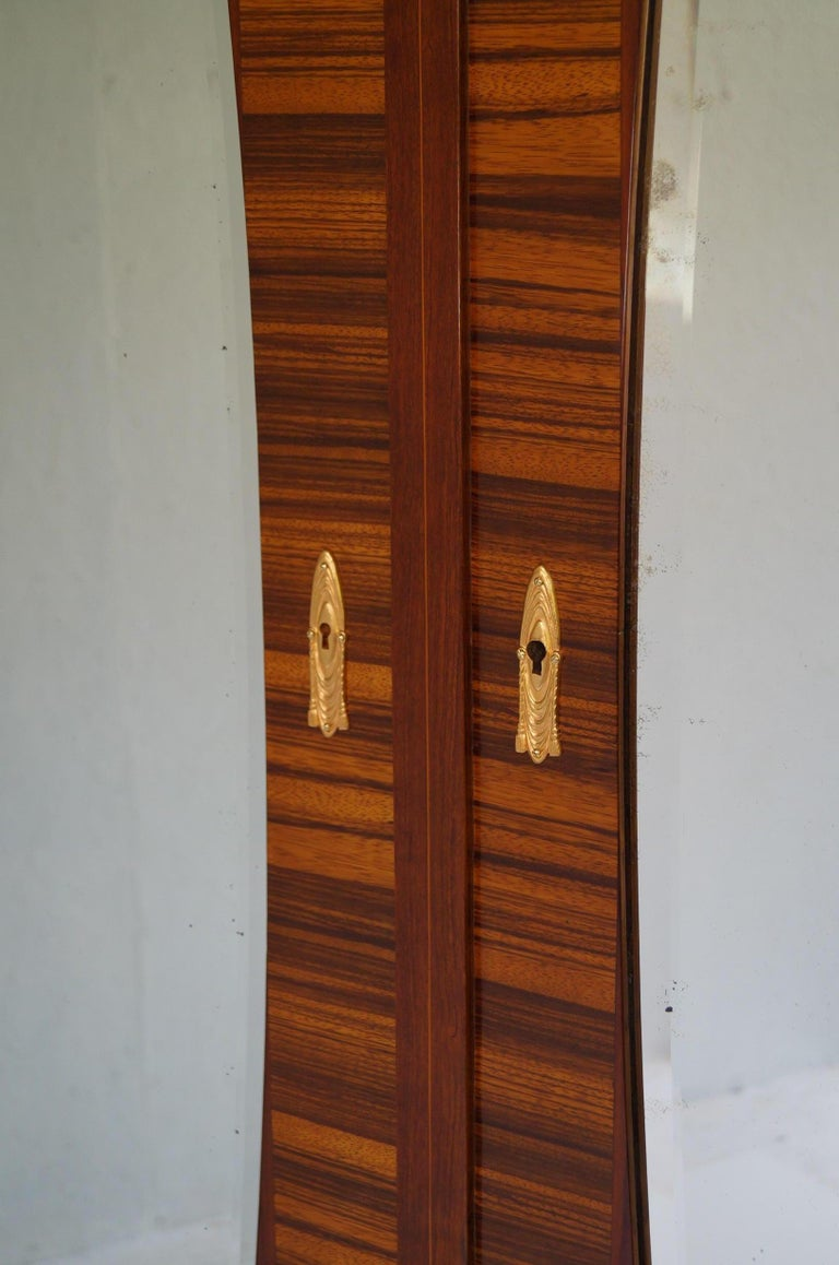 Art Deco Secesja wardrobe we are pleased to present the Polish Secession of 1900s-1910s. The wardrobe was made in Krakow, Poland, it comes from the Krakow Center, it was made of elmwood. The wardrobe was renovated, it was cleaned to bare veneer, and