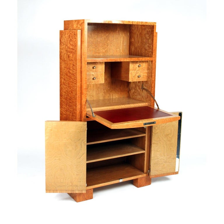 Art Deco secretaire desk with an ash veneer by Jacques Adnet. Made in France,  circa 1935.