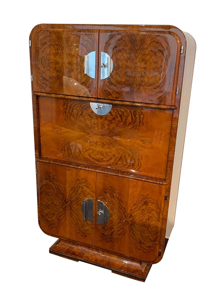 Rare and very elegant Art Deco Secretaire / writing cabinet in wonderful walnut Veneer from France, circa 1930.  Beautiful design with round edges. Secretaires from the Art Deco period are especially rare to find. Splendid book-matched French