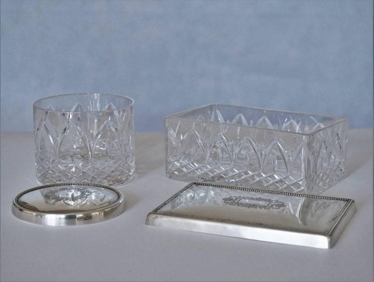 Set of two Art Deco boxes, beautifully handcut crystal and sterling silver top with engraved ornaments, by Topázio, Portugal, 1930-1939. Hallmarked: Topázio poincon. Rectangular box: Width 6 in, depth 4 in, height 2.50 in (15 cm x 10 cm x 6.5