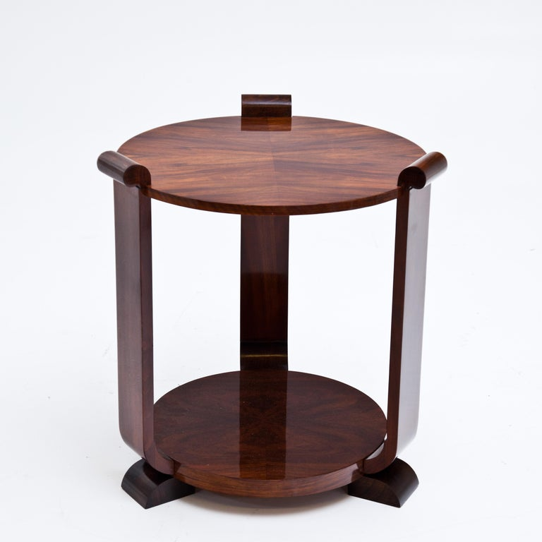 Art Deco side tables with round shelves supported by three legs. Very nice veneer, hand-polished.