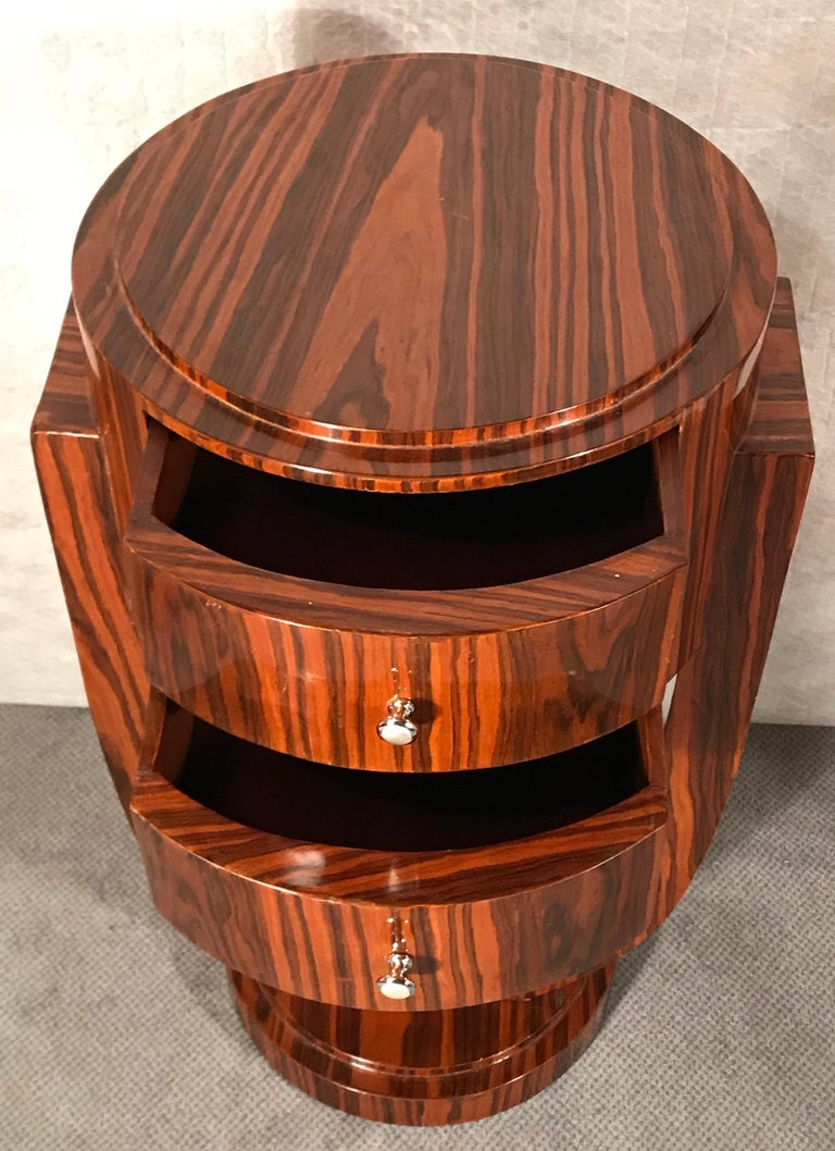 Art Deco side table, France 1920-1930. This beautiful original Art Deco side table was made circa 1920-1930 in France. The elegant design of the two drawer table is embellished with an exquisite Makassar ebony wood veneer.