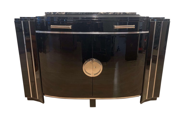 Elegant Art Deco sideboard with curved / convex doors, black lacquer, mahogany and chromed parts, from France, circa 1930.  Walnut solid wood corpus elaborately lacquered with black lacquer and high-gloss polished. Originally is had a dark stained