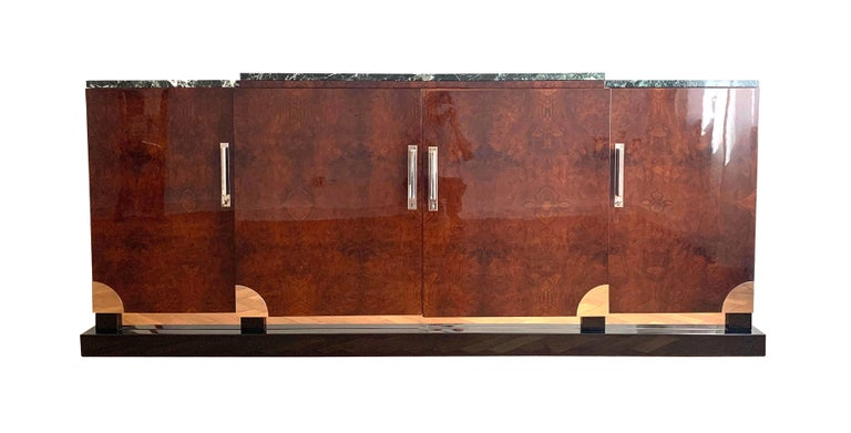 Amazing, large Art Deco sideboard from Southern France, circa 1930.  Very expressive walnut roots veneered on oak. Lacquered with clear piano lacquer. Four doors and chromed handles quarter round fittings in the corners. Black lacquered plinth