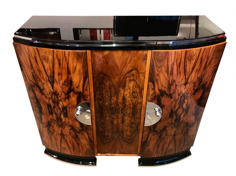 Wonderful classic and original Art Deco Sideboard from France about 1930.   Beautiful book-matched Walnut Veneer on the front. Two cylindric/concave front doors with polished, chromed fittings and handles.  The Sideboard has been elaborately