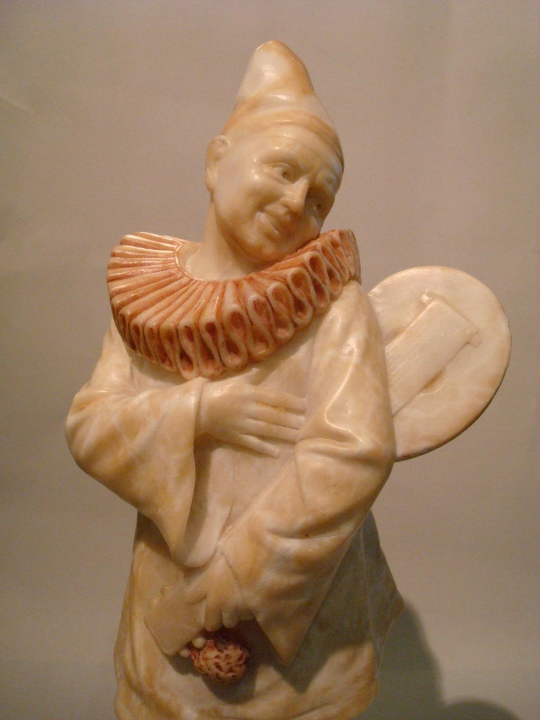 Art Deco signed Alabaster pierrot clown sculpture. Pierrot sculpture playing the mandolin.  The figure is signed, but i cannot read what it says.