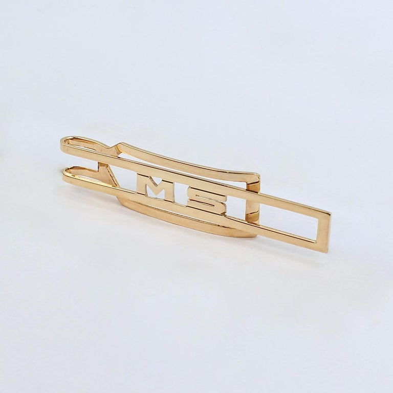 A very fine 14k Cartier gold tie bar.  With an integral script MS monogram.  Made by Larter & Sons for Cartier.  Together with its original period box.  A great tie bar for the