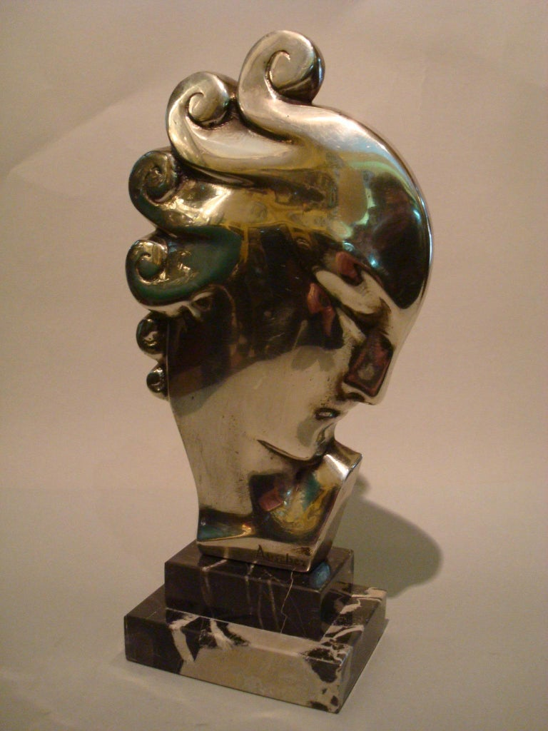 Art Deco bust of a woman. Silvered bronze sculpture of a moderniste lady. Mounted over a Italian marble base. Signed on the base Auscher. France 1930 Perfect desk piece or paperweight.