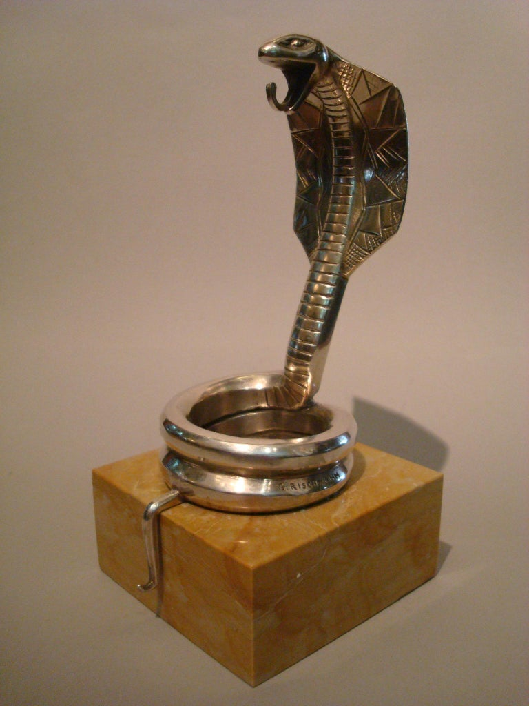 Art Deco silvered bronze cobra paper weight or watch stand by Rischmann, France, 1920s. Silvered bronze sculpture of a cobra figure, mounted on a light brown marble base. Signed: G. Rischmann.
