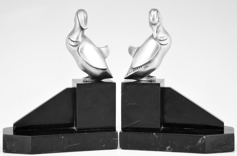 """A lovely pair of Art Deco silvered bronze duck bookends on black marble bases. Signed by the French artist Georges H Laurent, circa 1925  Similar pairs are illustrated in the book: """"Art Deco and other figures"""" by Brian Catley. ?? General"""