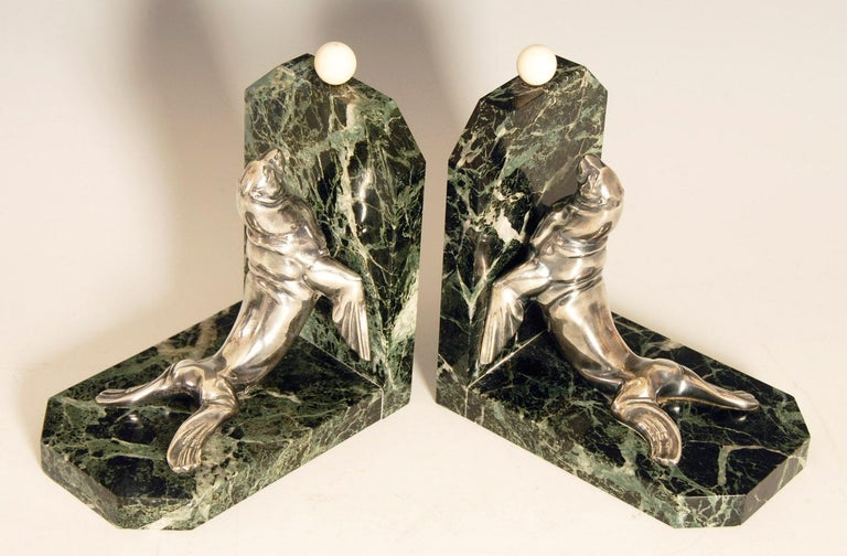 Large, heavy pair of Art Deco bookends by Maurice Frecourt, featuring silvered bronze sea lions / seals on green veined marble. Weighing in at around 5.5 lbs each, these are very substantial bookends.  Price includes free shipping to anywhere in