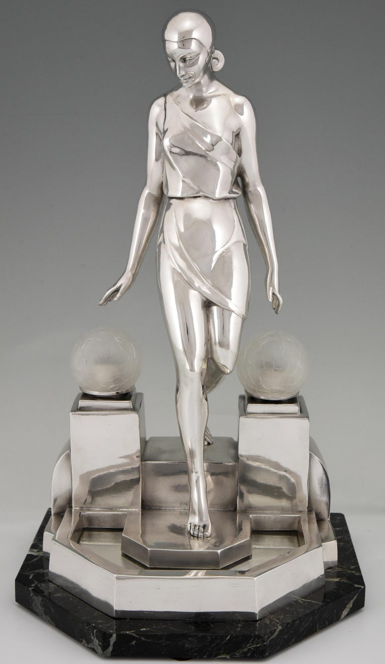 Stylish Art Deco sculptural table lamp by Pierre Le Faguays, titled Nausicaa. The lamp is a picturing a woman walking down a fountain,  The sculpture is signed Fayral for Pierre Le Faguays and was cast by the Le Verrier foundry. The sculpture is