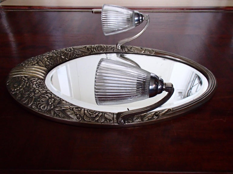 Early 20th Century Art Deco Small Floral Brass Wall Mirror with Pair of Lights For Sale