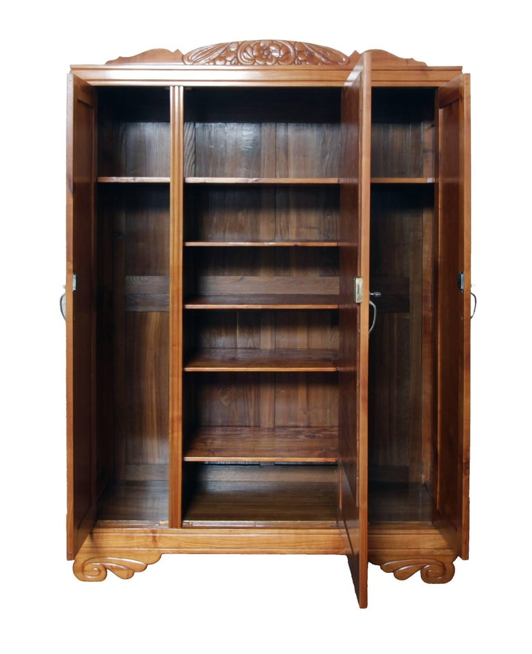 The Art Deco cabinet from circa 1920 from Germany was made in solid cherrywood. The cabinet can be disassembled and shipped disassembled. The cabinet consists of: Lower part, upper part, three doors, two side parts, the rear wall and several