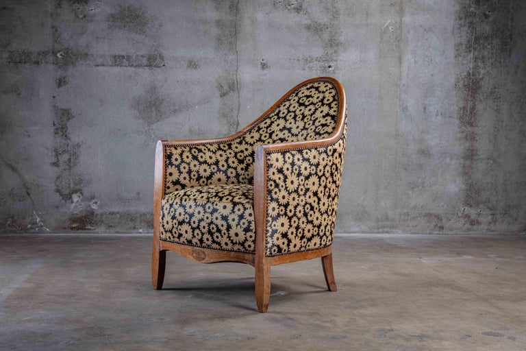 Art Deco spoon back armchair, 1920s, upholstered in flower printed leather  Measures: Seat 17 in  Arm 25 in.