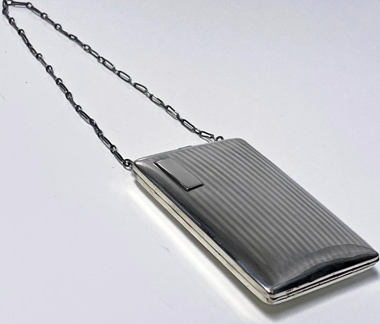 Art Deco sterling combination sovereign compact card or cigarette Case, American, circa 1920 by Webster Co. Rectangular cushion shape with hand chain attached. Opens to reveal half and full sovereign holders, mirror compact and the other side for