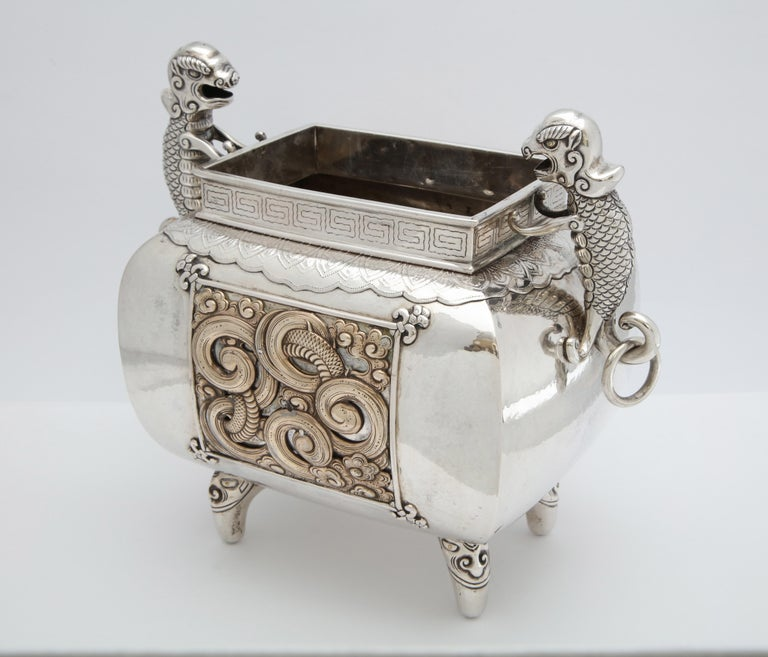 Meiji Period, sterling silver (unmarked, but tested as 9.50 silver), footed, Japanese centerpiece with salamander handles and gilded brass inserts as part of the design, Japan, circa 1910. Each ringed handle is mounted by a salamander. Stands 8 3/4