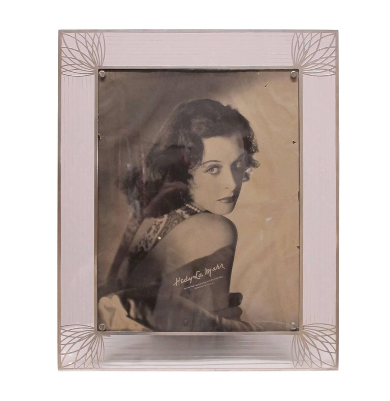 Very pretty and larger size Art Deco period sterling silver overlay and glass easel back picture frame with Fine silver striping on the glass surround, having a studio photograph of Hedy Lamar.