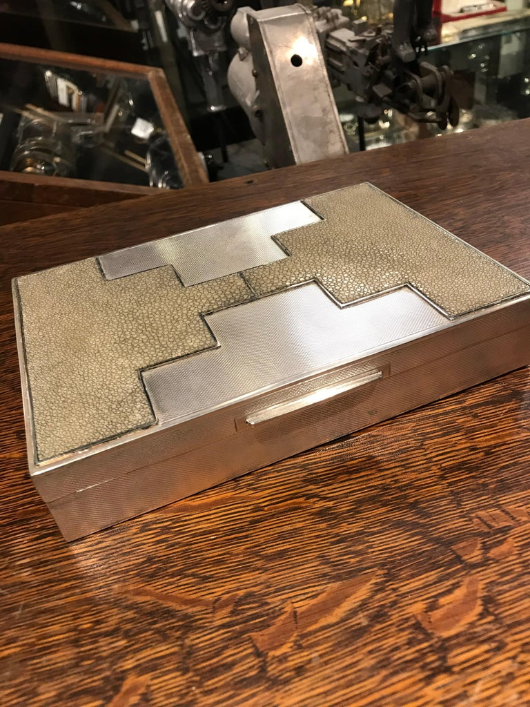 An incredible example of Art Deco luxury. This box has an engine turned texture with shagreen embellished in a skyscraper motif. Great scale and exemplary craftsmanship.