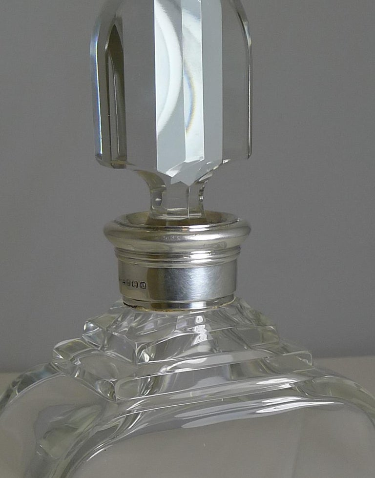 A magnificent top-notch English cut crystal decanter by the crème de la crème of English silversmith's and retailers, Asprey and Co. Ltd.  Asprey, founded in 1781 by William Asprey, was originally based in Mitcham, Surrey until the company moved