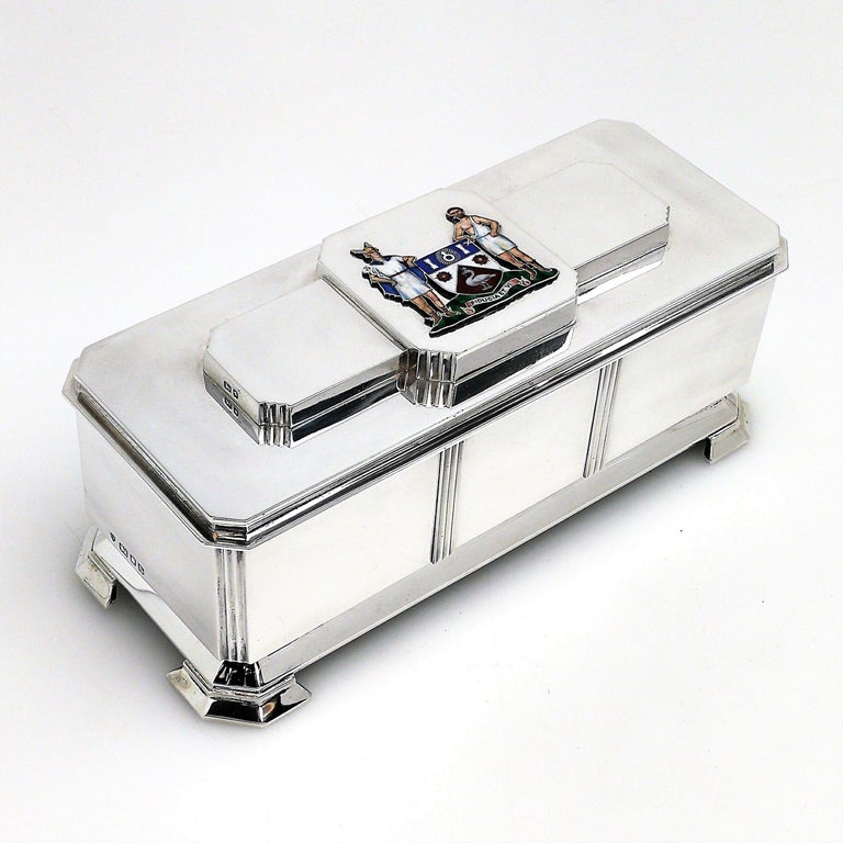An impressive Art Deco solid Silver Freedom Box embellished with the arms of the Borough of Slough in deep rich enameled colors. The interior of the base is lined with an ivory colored fabric and the interior of the lid is gilded.     Approx. Length