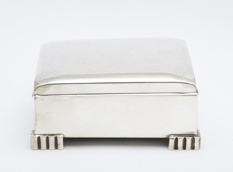 Art Deco, sterling silver table box with hinged lid. Poole Silver Co., Taunton, Mass., circa 1930s. Measures 4 inches wide (from foot to foot) x 3 1/2 inches deep (from foot to foot) x 1 1/2 inches high. Wood lined. One very tiny dint in upper right