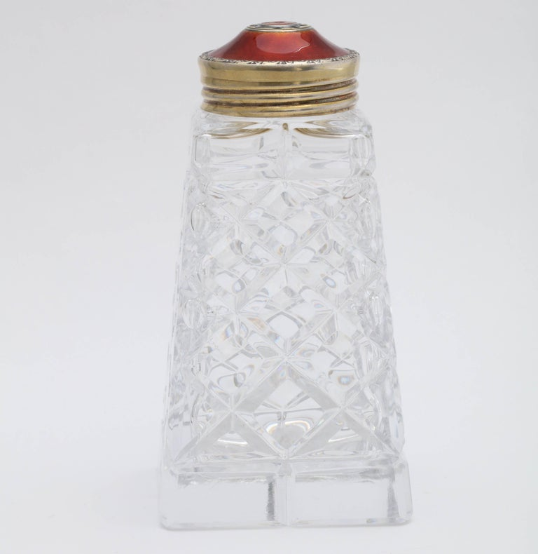 Art Deco, sterling silver-gilt and Red Guilloche enamel - mounted cut crystal sugar shaker, Oslo, Norway, Hroar Prydz - maker (worked from 1859-1937). Measures 5 inches tall 2 1/2 inches wide (at widest point 1/2 inches deep. (at deepest point).