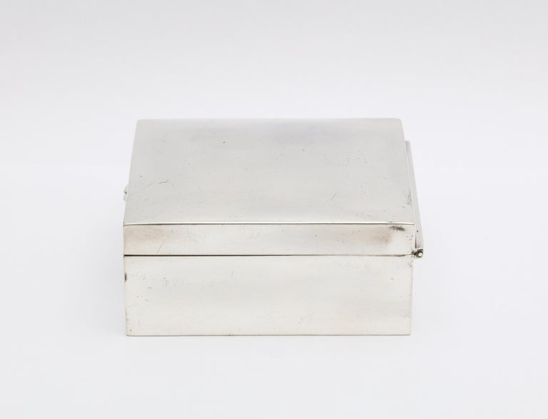 Art Deco, sterling silver table box with hinged lid, Shreve and Co., San Francisco, circa 1915. Measures: 3 1/2 inches wide x 3 1/2 inches deep x 3 1/2 high. Wood lined; leather underside. Underside of hinged lid is gilded. Dark spots in photos are
