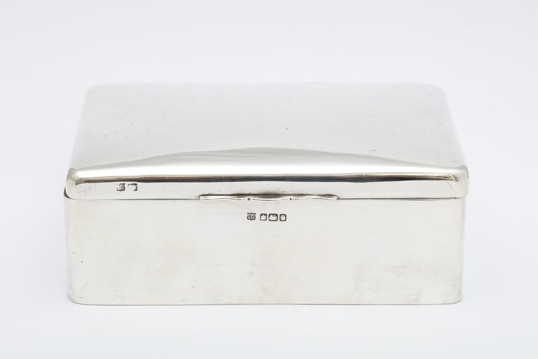 Art Deco, sterling silver table box with hinged lid, Sheffield, England, 1933, Fenton Bros., Ltd. - makers. Wood lined. Measures: 5 1/4 inches wide x 3 3/4 inches deep x 2 inches high. Lovely, clean lines. Has a few dints to the silver commensurate