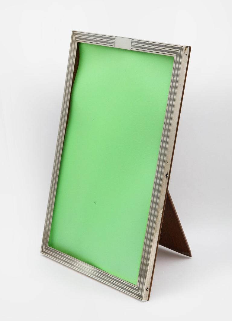 Art Deco, sterling silver, tuxedo-striped picture frame with wood back, Birmingham, England, year-hallmarked for 1925, Charles S. Green and Co., Ltd. - makers. Vacant cartouche. Measures 10 3/4 inches high x 7 1/2 inches wide x 7 1/4 inches deep