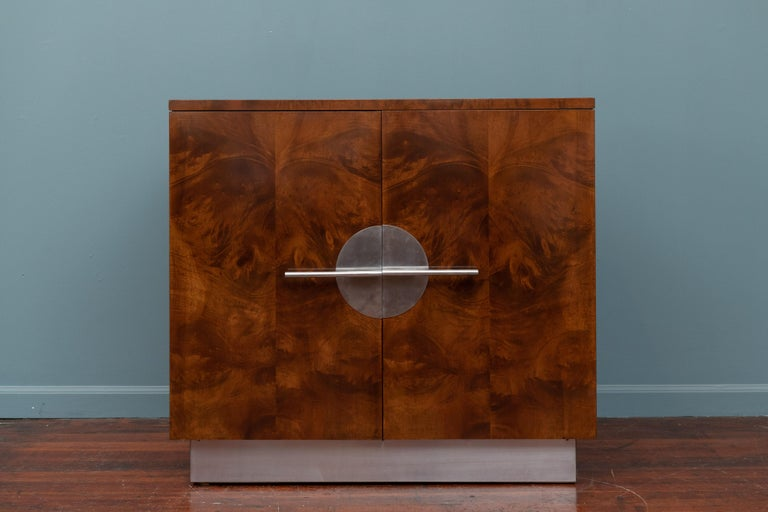 Art Deco streamline cabinet designed by Walter Dorwin Teague for Hastings. Originally a server for a dining suite but perfect as a bar cabinet or storage. Newly refinished, polished and painted.