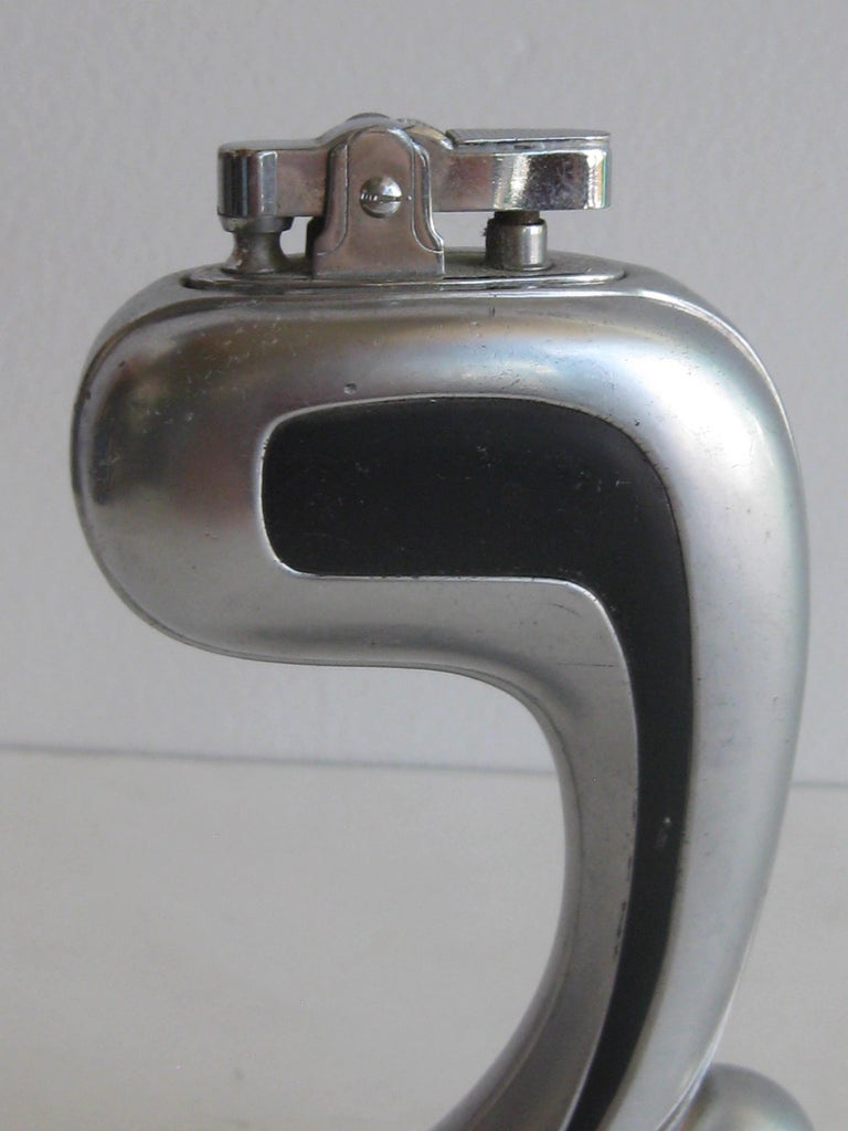 Great Art Deco streamline skyscraper figural table lighter. Made of metal and has a brushed finish. The lighter insert is stamped