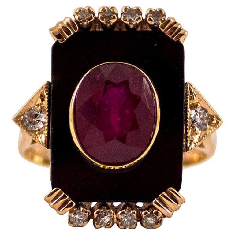 Art Deco Style 0.18 Carat White Diamond 2.10 Carat Ruby Onyx Yellow Gold Ring