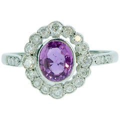 Art Deco Style 0.78 Carat Pink Sapphire Cluster Ring in Diamond Halo Surround