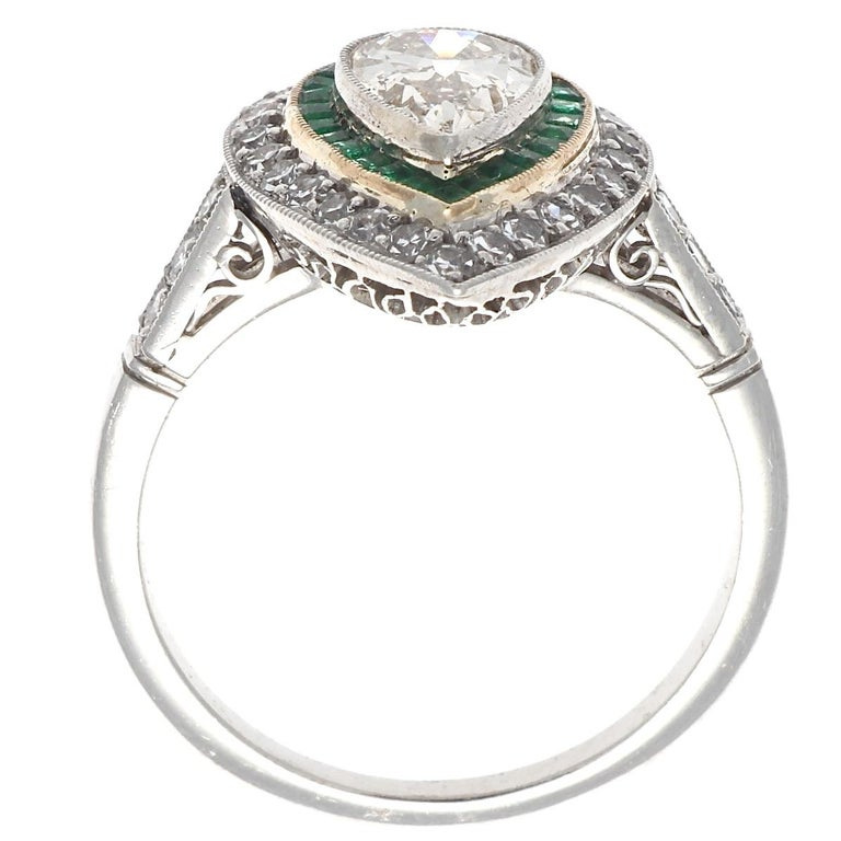Pear Cut Art Deco Style 1 Carat Old Pear Shaped Diamond and Emerald Platinum Ring For Sale