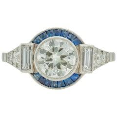 Art Deco Style 1960s 1.11 Carat Diamond Ring with Sapphire Halo in Platinum