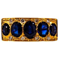 Art Deco Style 2.10 Carat White Diamond Oval Cut Blue Sapphire Yellow Gold Ring