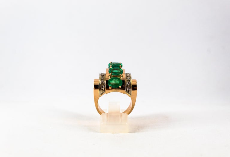 This Ring is made of 14K Yellow Gold. This Ring has 0.30 Carats of White Brilliant Cut Diamonds. This Ring has 4.00 Carats of Oval Cut Emeralds. This Ring is available also with Rubies or Blue Sapphires. Size ITA: 19 USA: 8 3/4  We're a workshop so
