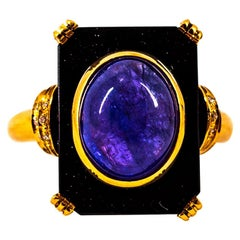 Art Deco Style 4.35 Carat White Diamond Tanzanite Onyx Yellow Gold Cocktail Ring